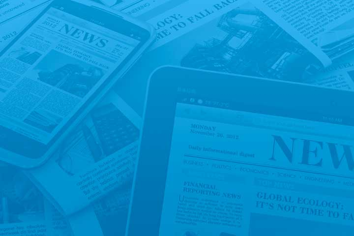 Blue tinted image of newspaper articles